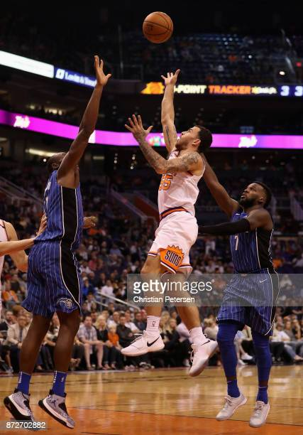 Mike James of the Phoenix Suns attempts a shot past Shelvin Mack of the Orlando Magic during the second half of the NBA game at Talking Stick Resort...