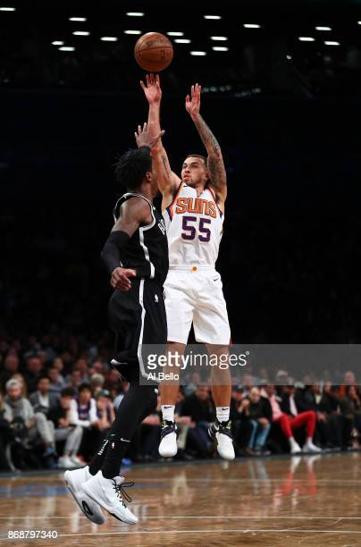 Mike James of the Phoenix Suns shoots against Rondae HollisJefferson of the Brooklyn Nets during their game at Barclays Center on October 31 2017 in...
