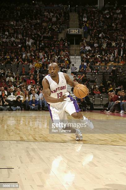 Mike James of the Toronto Raptors dribbles during the game against the Houston Rockets at Air Canada Centre on January 6 2006 in Toronto Ontario...