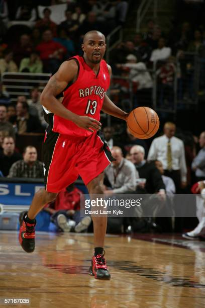 Mike James of the Toronto Raptors moves the ball against the Cleveland Cavaliers during the game at Quicken Loans Arena on March 7, 2006 in...