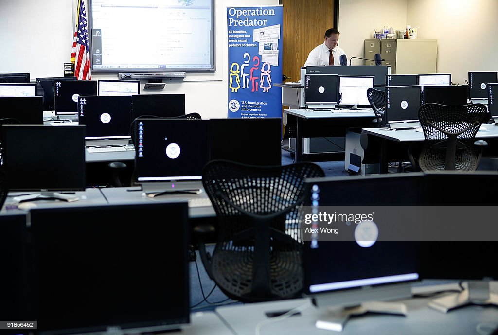 Mike Jedrey, a special agent of the Virginia State Police, works in a training room of the Cyber Crimes Center of the U.S. Immigration and Customs Enforcement October 13, 2009 in Fairfax, Virginia. The Cyber Crime Center, which is formed with the Child Exploitation Section, the Computer Forensics Section and the Cyber Crimes Section, focus on investigating criminal activities occur on or facilitated by the Internet. It also offers training to local, federal, and international law enforcement agencies.