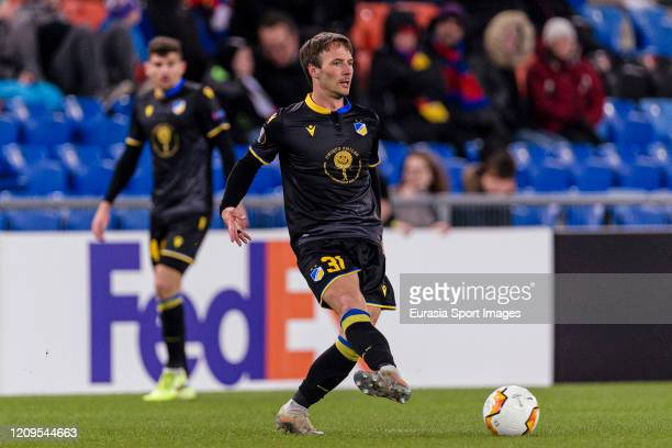 Mike Jensen of Apoel passes the ball during the UEFA Europa League round of 32 second leg match between FC Basel and APOEL Nikosia at St JakobPark on...