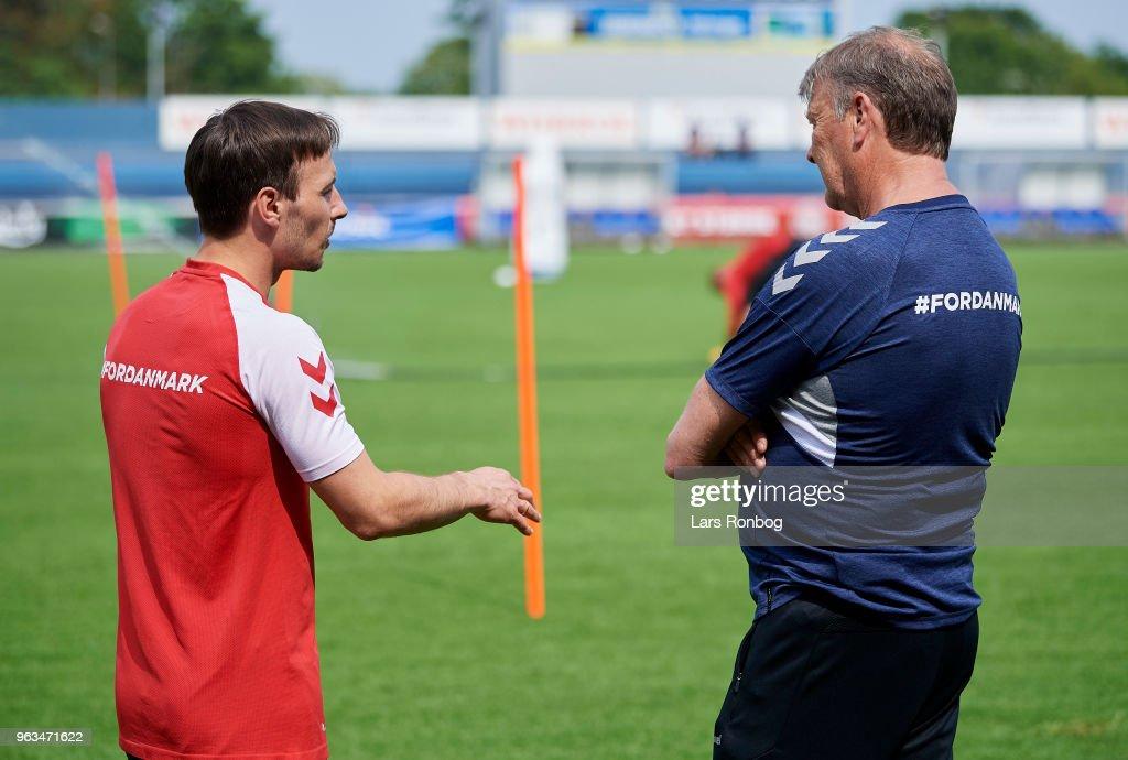Mike Jensen of Denmark speaks to Age Hareide, head coach of Denmark during the Denmark training session Helsingor Stadion on May 28, 2018 in Helsingor, Denmark.