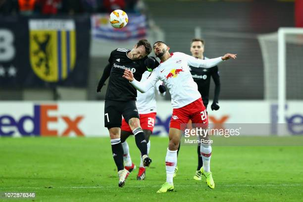 Mike Jensen of Rosenborg and Matheus Cunha of RB Leipzig battle for the ball during the UEFA Europa League Group B match between RB Leipzig and...