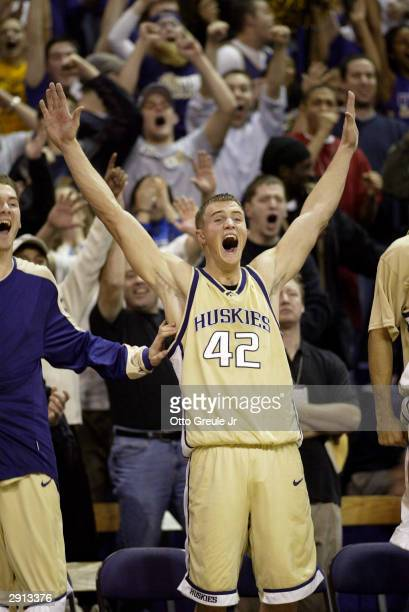 Mike Jensen of the Washington Huskies celebrates as the his team beat the Arizona Wildcats 9683 on January 29 2004 at Edmundson Pavilion in Seattle...
