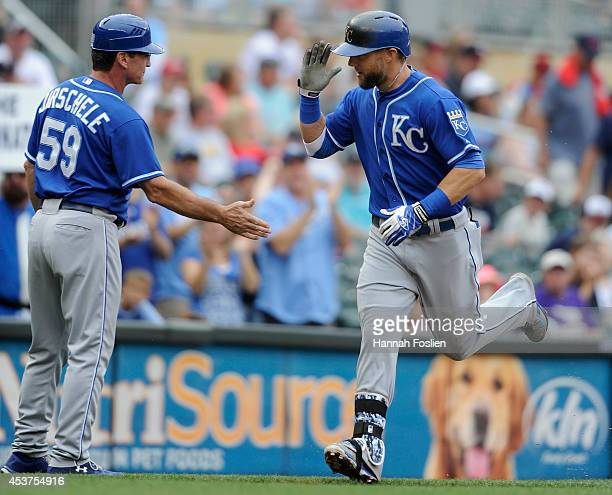 Mike Jirschele of the Kansas City Royals congratulates Alex Gordon on a tworun home run against the Minnesota Twins during the fifth inning of the...