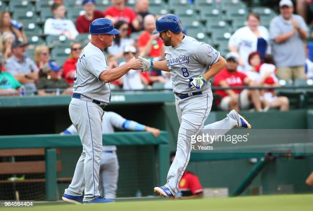 Mike Jirschele of the Kansas City Royals congratulates Mike Moustakas of the Kansas City Royals for hitting a two run home run in the first inning...