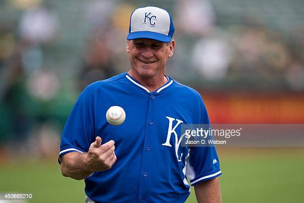 Mike Jirschele of the Kansas City Royals tosses a ball during batting practice before the game against the Oakland Athletics at Oco Coliseum on...