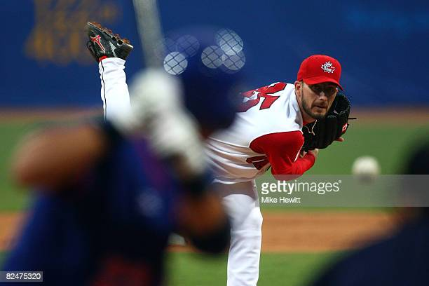 Mike Johnson of Canada pitches while taking on Chinese Taipei during the preliminary basketball game at the Wukesong Baseball Field during Day 12 of...
