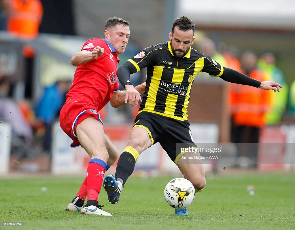 Mike Jones of Oldham Athletic and Robbie Weir of Burton Albion during the Sky Bet League One match between Burton Albion and Oldham Athletic at Pirelli Stadium on March 26, 2016 in Burton-upon-Trent, England.