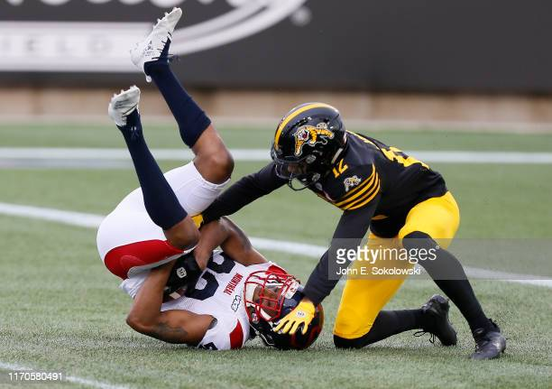 Mike Jones of the Hamilton TigerCats tackles Tommie Campbell of the Montreal Alouettes after an interception at Tim Hortons Field on June 28 2019 in...