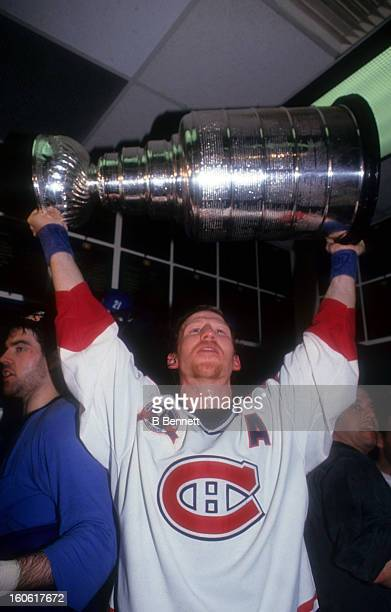 Mike Keane of the Montreal Canadiens holds the Stanley Cup in the locker room after the Canadiens defeated the Los Angeles Kings in Game 5 of the...