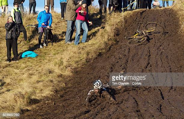 Mike Kelly falls from his bike and slides down the muddy hillside during the thrills and spills of the New Zealand Cyclocross Championships sponsored...