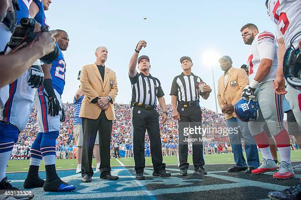 Mike Kelly watches the official coin toss prior to the game between the Buffalo Bills and the New York Giants at the 2014 NFL Hall of Fame Game at...