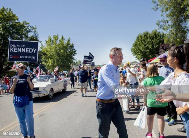 Mike Kennedy Republican US Senate candidate center waves while campaigning at the Strawberry Days Parade in Pleasant Grove Utah US on Saturday June...