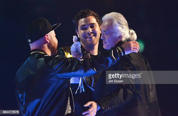 Mike Kerr and Ben Thatcher of Royal Blood receive the best british band award from Jimmy Page at the BRIT Awards 2015 at The O2 Arena on February 25...
