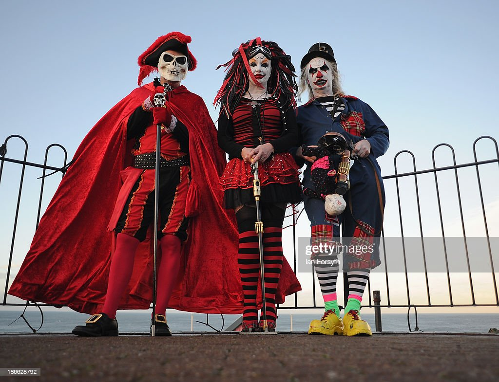 Mike Kershaw from Sheffield, Valery Bailey from Rotherham and her husband Tony Bailey pose for a photograph at the Goth weekend on November 2, 2013 in Whitby, England. The Whitby Gothic Weekend that takes place in the Yorkshire seaside town twice yearly in Spring and Autumn started in 1994 and sees thousands of extravagantly dressed followers of Victoriana, Steampunk, Cybergoth and Romanticism visit to take part in celebrating Gothic culture.