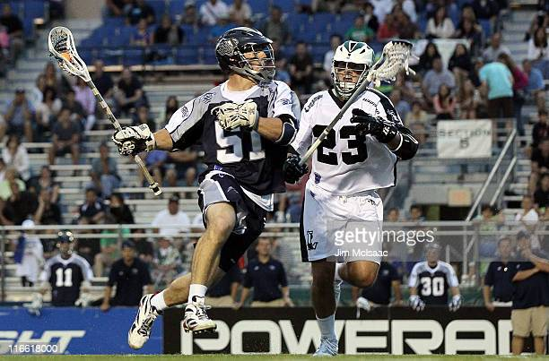 Mike Kimmel of the Chesapeake Bayhawks controls the ball against Mike Ward of the Long Island Lizards during their Major League Lacrosse game on June...