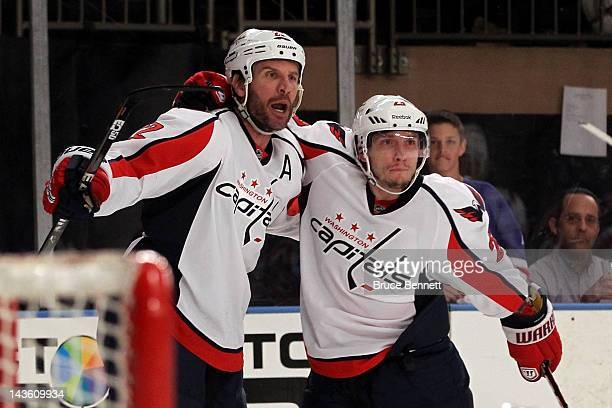 Mike Knuble oand Keith Aucoin of the Washington Capitals celebrate after Knuble scored a first period goal against the New York Rangers in Game Two...