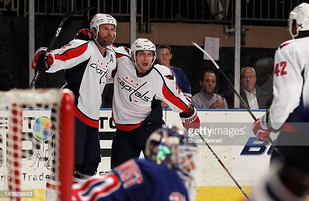 Mike Knuble oand Keith Aucoin of the Washington Capitals celebrate after Knuble scored a first period goal against goalie Henrik Lundqvist of the New...