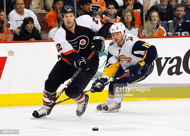 Mike Knuble of the Philadelphia Flyers passes the puck in front of Tim Connolly of the Buffalo Sabres at the Wachovia Center March 10 2009 in...