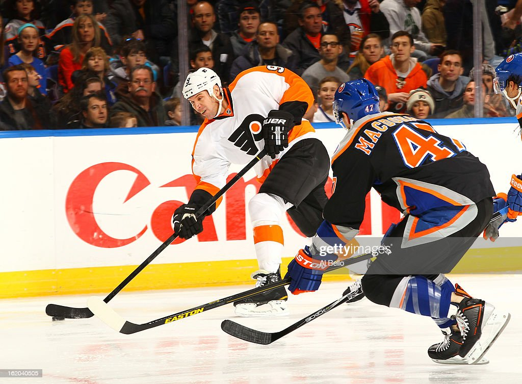 Mike Knuble #9 of the Philadelphia Flyers shoots the puck as Andrew MacDonald #47 of the New York Islanders defends during their game at Nassau Veterans Memorial Coliseum on February 18, 2013 in Uniondale, New York.