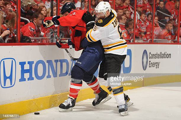 24e414e965e Mike Knuble of the Washington Capitals and Greg Zanon of the Boston Bruins  fight for the