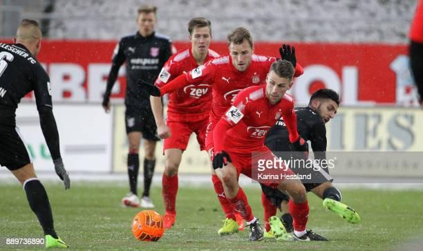 Mike Koennecke and Nils Miatke of Zwickau challenge Hilal ElHelwe of Halle during the 3Liga match between FSv Zwickau and Hallescher FC at Stadion...