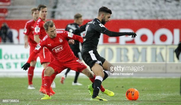 Mike Koennecke of Zwickau challenges Hilal ElHelwe of Halle during the 3Liga match between FSv Zwickau and Hallescher FC at Stadion Zwickau on...