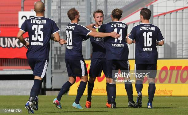 Mike Koennecke of Zwickau jubilates with team mates after scoring the first goal during the 3. Liga match between FC Energie Cottbus and FSV Zwickau...