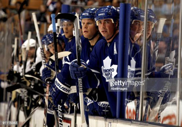 Mike Komisarek and Tomas Kaberle of the Toronto Maple Leafs watch from the bench during a preseason NHL game against the Pittsburgh Penguins at the...