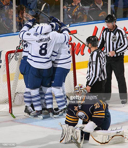 Mike Komisarek, Dion Phaneuf, Tim Brent and Joey Crabb celebrate Crabb's game winning goal behind Ryan Miller of the Buffalo Sabres the Toronto Maple...