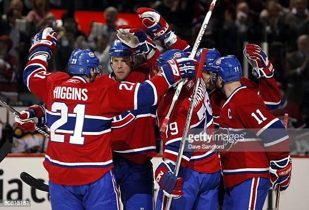 Mike Komisarek of the Montreal Canadiens celebrates his goal against the Boston Bruins with teammates Christopher Higgins Saku Koivu and Andrei...