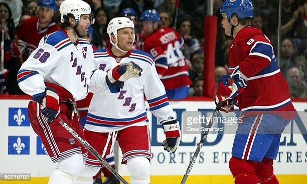Mike Komisarek of the Montreal Canadiens taunts Sean Avery and Jaromir Jagr both of the New York Rangers during their NHL game at the Bell Centre...