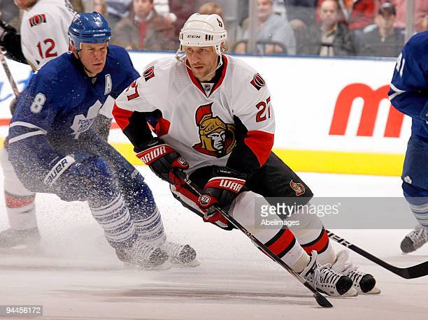 Mike Komisarek of the Toronto Maple Leafs tracks Alexei Kovalev of the Ottawa Senators during action December 14 2009 at the Air Canada Centre in...