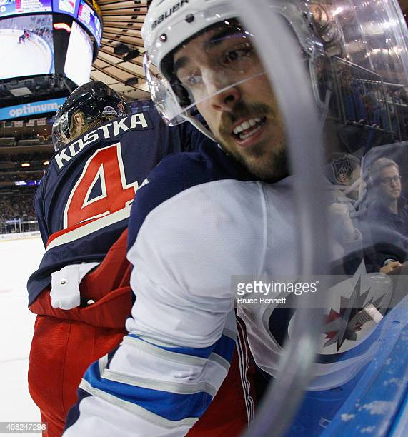 Mike Kostka of the New York Rangers backs into Mathieu Perreault of the Winnipeg Jets during the first period at Madison Square Garden on November 1...