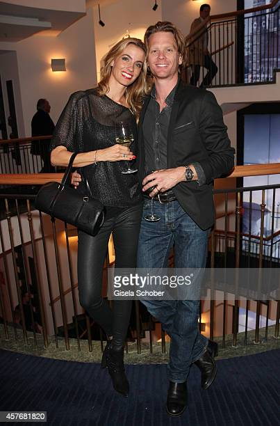 Mike Kraus and his wife Coco attend the Hirmer store re-opening on October 22, 2014 in Munich, Germany.