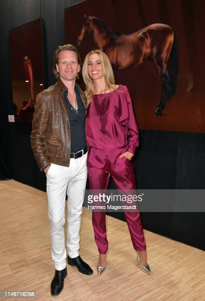 Mike Kraus and his wife Constanze Coco Kraus attend the Veneration exhibition opening in cooperation with photographer Mike Kraus on May 16 2019 in...