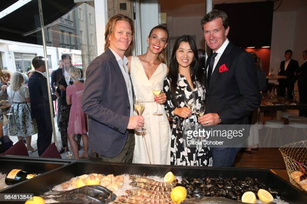"Mike Kraus and his wife Constanze, ""Coco"" Kraus, John Juergens, DJ John Munich and his wife Hayah Juergens during the opening of the first ""Krug..."
