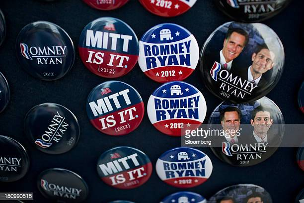 Mike Kriener of Citrus County Florida sells buttons as delegates guests and young Republicans make their way into the Tampa Bay Times Forum on the...