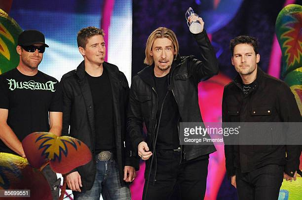 Mike Kroeger Daniel Adair Chad Kroeger and Ryan Peake of Nickelback accept the Juno Award for Group of the Year during the 2009 Juno Awards at...