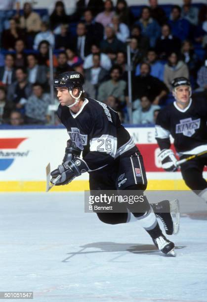 Mike Krushelnyski of the Los Angeles Kings skates on the ice during an NHL game against the New York Islanders on October 30 1990 at the Nassau...