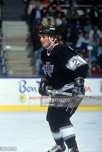 Mike Krushelnyski of the Los Angeles Kings skates on the ice during an NHL game against the New York Islanders on October 30, 1990 at the Nassau...
