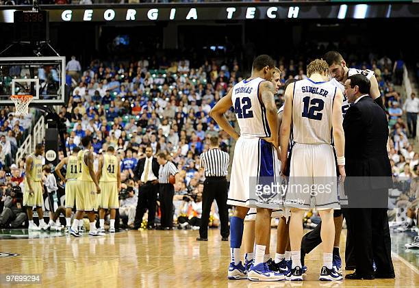 Mike Krzyzewski head coach of the Duke Blue Devils confers with players during a timeout against the Georgia Tech Yellow Jackets in the championship...