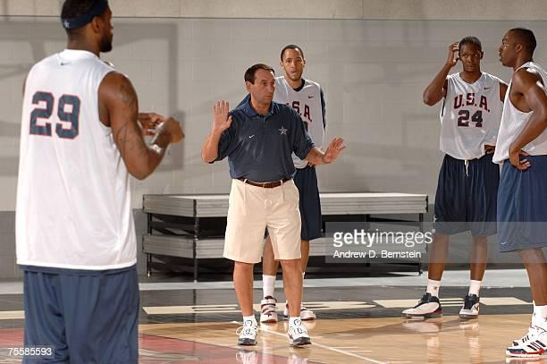 Mike Krzyzewski, Head Coach of the USA Men's Senior National Basketball Team talks to LeBron James, Tayshaun Prince, Chris Bosh and Dwight Howard...