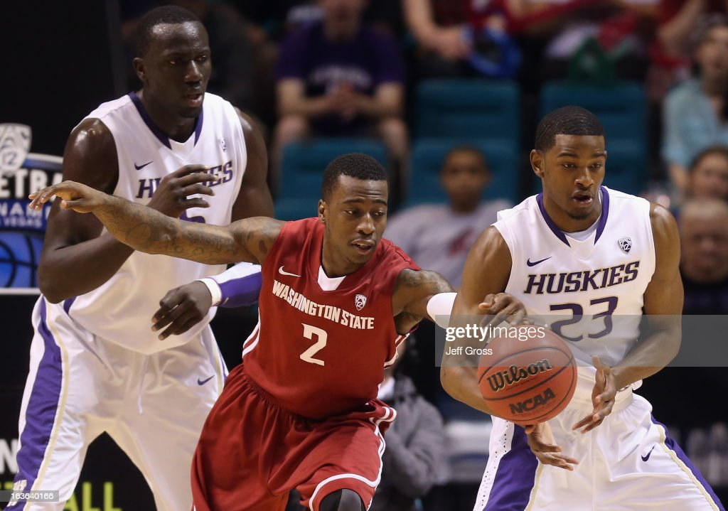 Mike Ladd #2 of the Washington State Cougars steals the ball from C.J. Wilcox #23 of the Washington Huskies in the first half during the first round of the Pac 12 Tournament at the MGM Grand Garden Arena on March 13, 2013 in Las Vegas, Nevada.