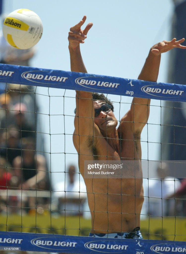 Mike Lambert blocks a spike back into the opponents' side during the championship match against Matt Fuerbringer and Casey Jennings. Lambert and his partner Karch Kiraly won the $14,500 purse in Manhattan Beach, California on June 6, 2004.