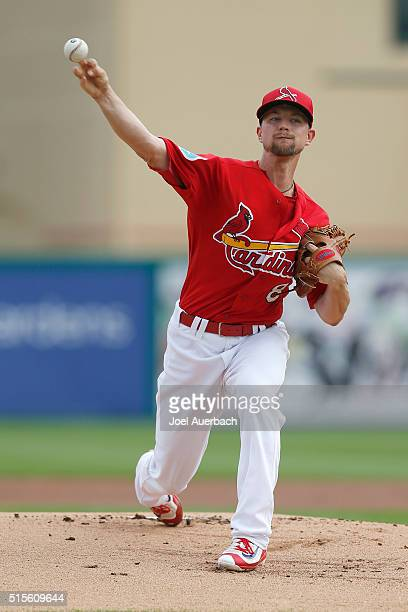 Mike Leake of the St Louis Cardinals throws the ball against the Minnesota Twins during a spring training game at Roger Dean Stadium on March 14 2016...