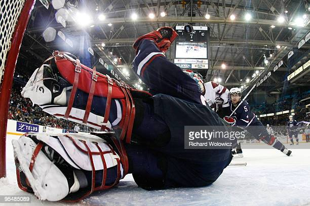 Mike Lee of Team USA stops the puck during the game against Team Latvia at the 2010 IIHF World Junior Championship Tournament game on December 29...