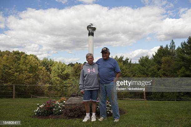Mike Leighton 68 years and his wife stand next to a venting pipe for their contaminated water well September 10 2012 at his home in Granville Summit...